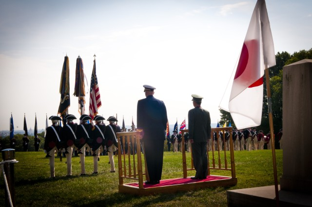 "U.S. Army Chief of Staff Gen. Raymond T. Odierno (left on stage) and Japanese Ground Self-Defense Force Chief of Staff Gen. Eiji Kimizuka (right on stage), observe members of the 3d U.S. Infantry Regiment (The Old Guard) conduct ""march on"" during Kimizuka's award ceremony, Sept. 27, 2012, Joint Base Myer-Henderson Hall, Va.  Gen. Kimizuka received the award for promoting family welfare through the development of a Japan Ground Self-Defense Force family support structure. (U.S. Army photo by Staff Sgt. Bernardo Fuller)"