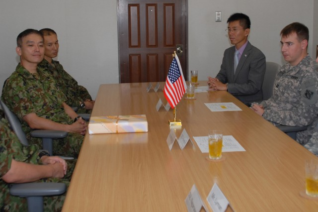 (From left): Japan Ground Self-Defense Force Maj. Gen. Masafumi Akamatsu, Capt. Thomas Douglas and Lt. Col. James C. Horton Jr., commence the 2012 Unit School Exchange Program between the JGSDF and the Japan Engineer District.