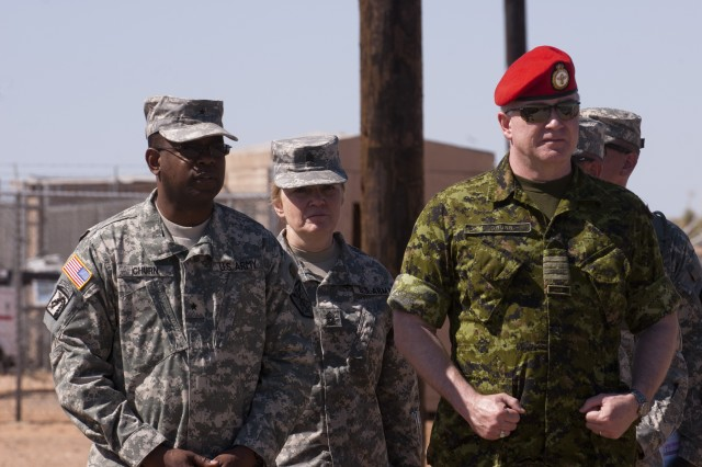 Brig. Gen. Phillip Churn, commander of the 333rd Military Police Brigade, Command Sgt. Maj. Abbe Mulholland, the 300th Military Police Brigade's senior enlisted Soldier, and Canadian Col. Tim Grubb watch 200th Military Police Command Soldiers and Canadian Forces military police conduct joint training during exercise Guardian Justice 2012 Camp McGregor, N.M., from May 14-15. McGregor is a remote training area of Fort Bliss, Texas. The partnership brings together the nearly 14,000 Soldiers assigned to the Fort Meade-based 200th MPC with the Canadian Military Police Branch, which has more than 2,000 military members augmented by civilian personnel working within more than 90 units and detachments across Canada and at its headquarters in Ottawa.