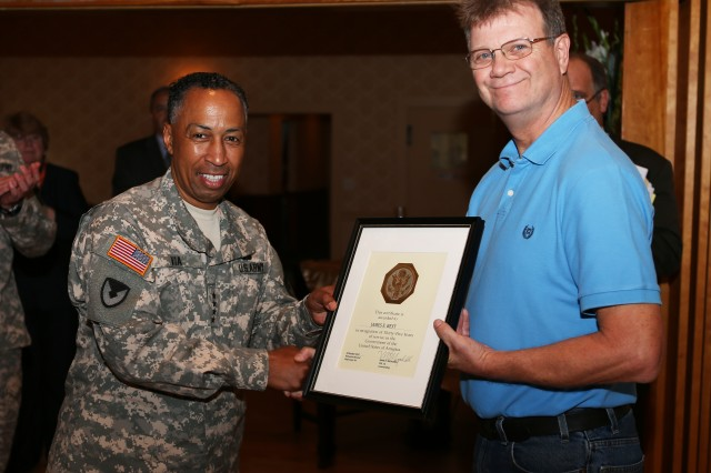 Gen. Dennis L. Via took sometime during his visit to the Watervliet Arsenal to meet the workforce and to give out awards.  James Best receives recognition for 35 years of service.