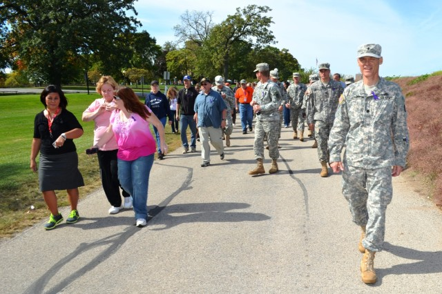 """Chaplain (Lt. Col.) Chuck Rizer, Army Sustainment Command, leads participants on a """"memory walk"""" during lunchtime Sept. 27 to share personal stories of people they knew who committed suicide. (Photo by Galen Putnam, ASC Public Affairs)"""
