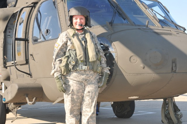 CW2 Trina Moreno, Corpus Christi Army Depot's first female maintenance test pilot, stands in front of a UH-60 Black Hawk before take-off.