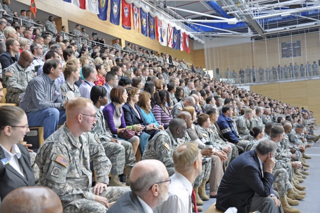Wiesbaden military community Soldiers and civilians listen to speakers during the garrison's suicide prevention standdown day.