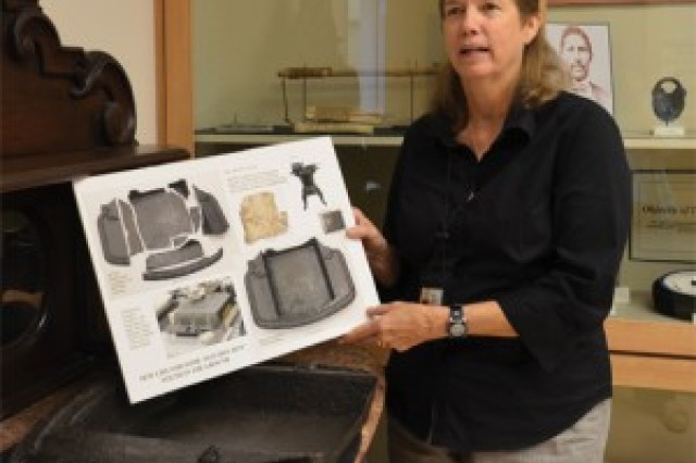 Carol Anderson explains the process used to clean and restore pieces of metal that were part of an 18th century stove found by archaeologists at Fort Lee.