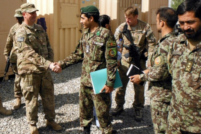 Members of First Army Division East Trainer Mentor Team-East meet with members of the Afghan National Army during the TMT transition at Camp Blackhorse.   The TMT, comprised of highly-trained officers and noncommissioned officers, mentor and advise Afghan units as they conduct security operations.