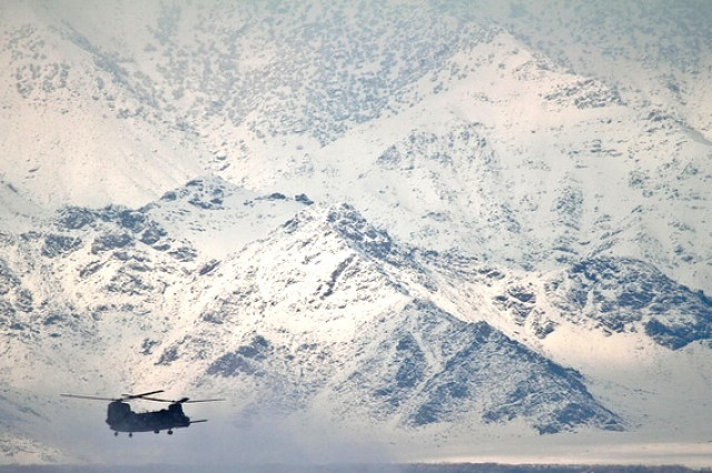 A CH-47 Chinook helicopter travels on a resupply mission to a remote base in Afghanistan, Feb. 4, 2012. New developments in engine technology are enabling helicopters to fly further on less energy.