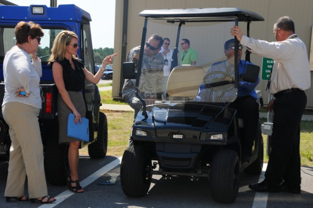 Members of departments operating at Lowe Army Heliport examine the three potential electric carts that might replace the current diesel carts.