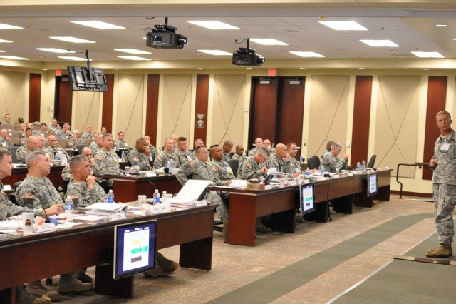(From left) Maj. Gen. Leslie J. Carroll, U.S. Army Forces Command chief of staff, Lt. Gen. William B. Garrett III, FORSCOM deputy commanding general, Command Sergeant Major Darrin J. Bohn, FORSCOM command sergeant major, Gen. David M. Rodriguez, FORSCOM commanding general, and senior leaders from across the command listen as Col. Paul Roege, chief of the Army Operational Energy Office, Office of the Deputy Chief of Staff, G-4, discusses operational energy during the FORSCOM Commander's Forum held at the command's Fort Bragg, N.C. headquarters.  Photo by Carol Eubanks, FORSCOM Public Affairs