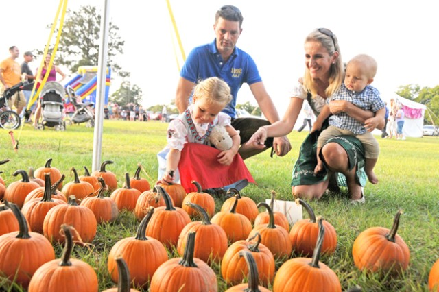 Capt. Markus Haake, E. Co., 1st Bn., 212th Avn. Regt., with his wife, Christine, and children, Isabella and Jonas, search for the perfect pumpkin at the pumpkin patch Sept. 28.