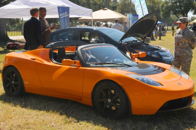 People check out the all-electric Tesla Roadster at last year's Energy Expo at Fort Rucker, Ala. The Department of Public Works hosts the event again this year, Oct. 10, 2012, from 9:30 a.m. to 2:30 p.m., at the Festival Fields, where the Roadster is scheduled to make another appearance.