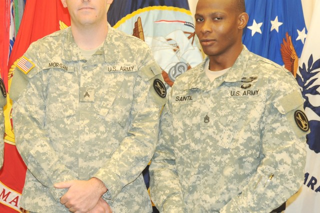 Cpl. Matthew T. Morgan, U.S. Army Military District of Washington, command group administrative non-commissioned officer, and his supervisor Staff Sgt. Yvens A. Saintil stand for a picture after Morgan's promotion to corporal at Fort Lesley J. McNair, Aug. 21.