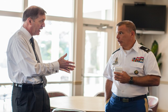 Karl Schneider, principal deputy assistant secretary of the Army (Manpower & Reserve Affairs), speaks to Garrison Commander Col. Edward C. Rothstein at The Conference Center at Fort Meade on Monday. Schneider briefed administrators of the University System of Maryland about Soldiers and veterans.