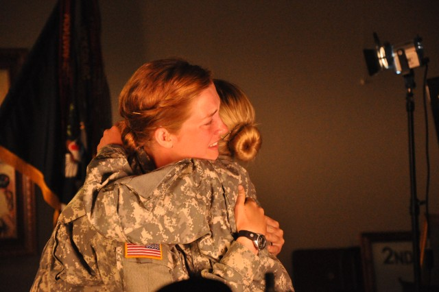 Pvt. Victoria Piccoli, left, gets a hug from battle buddy Pvt. Jaclyn Onuschak following Sunday morning's television interview.