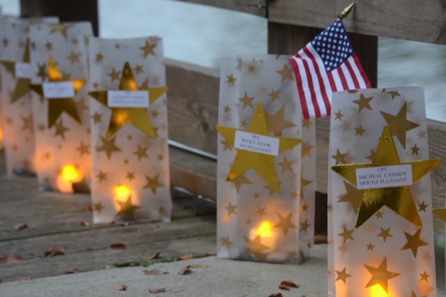 An electric candle is lit for each of the 295 Soldiers from South Carolina who has died while on active duty since 2001. Survivor Outreach Services hosted the Gold Star Mother's Day Luminary at the Lake Sunday at Semmes Lake.