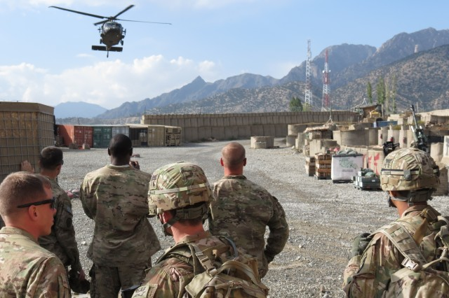 Rakkasans from the 3rd Battalion, 320th Field Artillery Regiment, 3rd Brigade Combat Team, 101st Airborne Division (Air Assault), wait for a UH-60 Blackhawk helicopter to land at Combat Outpost Herrera, Afghanistan, Sept 27, 2012. Soldiers eagerly stood on the flight line ready to assist with off-loading and loading of supplies and personnel. (Photo by: Army 1st Lt. Bryan Spears, 3-320th UPAR)