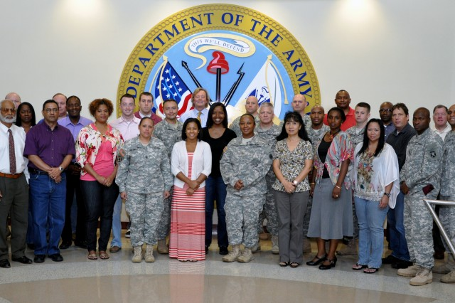 Students and instructor pose for a class group photo during the U.S. Army Forces Command (FORSCOM) hosted Manpower and Force Management Course at Fort Bragg, Sept. 17-28.  The course provides force management officers - uniformed and Department of the Army civilian, comptrollers and management analysts, the principles and skills necessary to analyze,  validate, and standardize Army force structure.