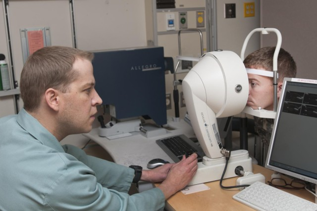 Clint Pugh, Ophthalmic technician, Laser Refractive Surgery Center, Madigan Healthcare System scans the cornea of 1st Lt. Christopher Griggs, executive officer, 14th Engineer Battalion, 555th Engineer Brigade, as part of the process to determine if he is a candidate to have the Photorefractive Keratectomy (PRK) or Laser-Assisted in Situ Keratomileusis (LASIK) procedure done on his eyes.The procedures are provided free of charge to active duty service members who meet specific criteria, as part of the Warfighter Refractive Eye Surgery Program developed by the Department of Defense. The program provides the procedures to boost mission readiness.