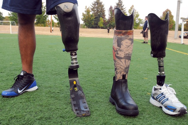 Silva selects among seven artificial legs for his various activities, three of which he displayed before his last intramural football practice.