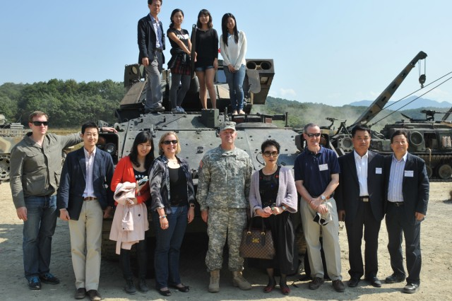 Members of the American Chamber of Commerce, Good Neighbor Advisory Council and Korea International Trade Association watched a combined arms exercise at Rodriguez Live Fire Complex, South Korea, Oct. 4, 2012.