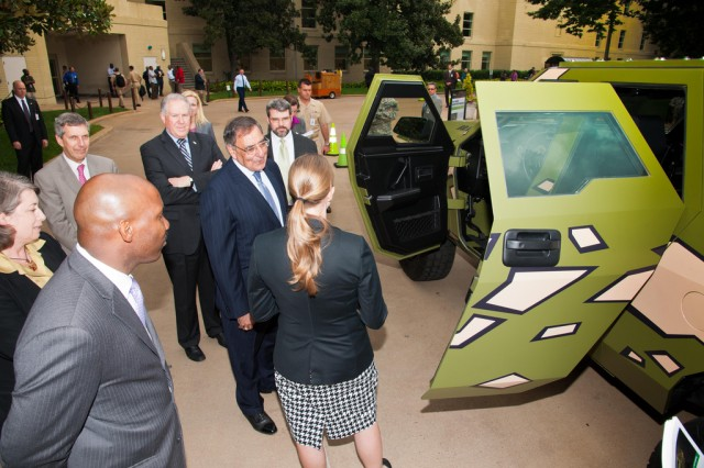 U.S. Army Research, Development and Engineering Command employees explain the Fuel Efficient Ground Vehicle Demonstrator Bravo's benefits to Secretary of Defense Leon Panetta (center) at the Pentagon, Oct. 4, 2012.
