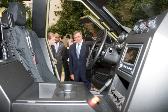 Secretary of Defense Leon Panetta (right) examines the U.S. Army Research, Development and Engineering Command's Fuel Efficient Ground Vehicle Demonstrator Bravo at the Pentagon, Oct. 4, 2012.