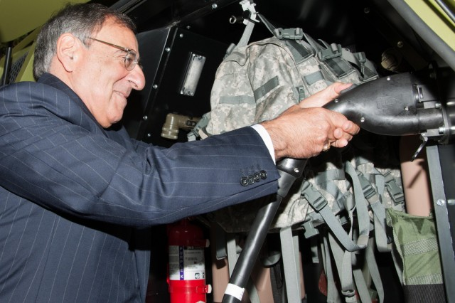 Secretary of Defense Leon Panetta examines the U.S. Army Research, Development and Engineering Command's Fuel Efficient Ground Vehicle Demonstrator Bravo at the Pentagon, Oct. 4, 2012.