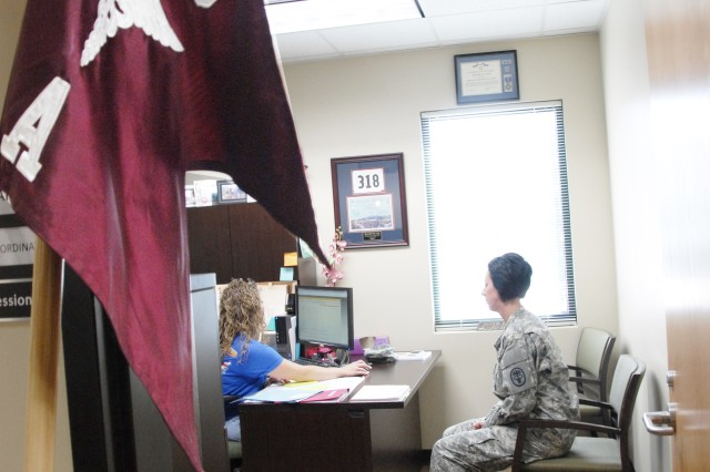 Spc. Hope Clark talks with Brandi Evans, A Company training coordinator, during her work-site program at the Warrior Transition Battalion on Fort Bliss, Texas.