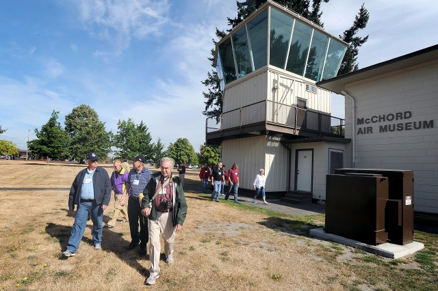 Army Air Corps 12th Bombardment Group veterans leave the McChord Air Museum Sept. 28 and head to the buses for a driving tour of McChord Field, Joint Base Lewis-McChord, Wash., at the group's final reunion.