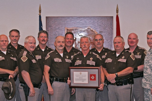 Oklahoma Highway Patrol Marine Enforcement Section Trooper Tony Richardson, center, his fellow troopers, and Tulsa District U.S. Army Corps of Engineers Commander Col. Michael Teague, far right, after Teague presented the Commander's Certificate of Appreciation to Richardson. The award, given for outstanding public service, was in recognition of Richardson's accomplishments in boating and water safety education.