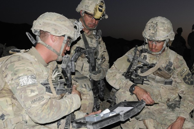 From left, Sgt. Chris Hagen, Command Sgt. Maj. Joseph Dallas and Staff Sgt. Nicholas Crosby prepare to use a chemical detection kit on detainees during Operation Southern Fist in the village of Obezhan Kalay, Spin Boldak district, Afghanistan, Sept. 29, 2012. The Afghan-led operation focused on denying the enemy freedom of maneuver and to connect local villagers with the Afghan government. The soldiers are part of the 2nd Infantry Division's 5th Battalion, 20th Infantry Regiment. The unit is from Joint Base Lewis-McChord, Wash.