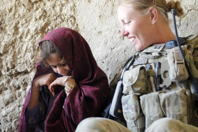 Capt. Pennie Llorente, civil affairs officer with the 426th Civil Affairs Battalion (Airborne), talks with an Afghan girl before a female shura during Operation Southern Fist in the village of Obezhan Kalay, Spin Boldak district, Afghanistan, Sept. 30, 2012. The Afghan-led operation focused on denying the enemy freedom of maneuver and to connect local villagers with the Afghan government.