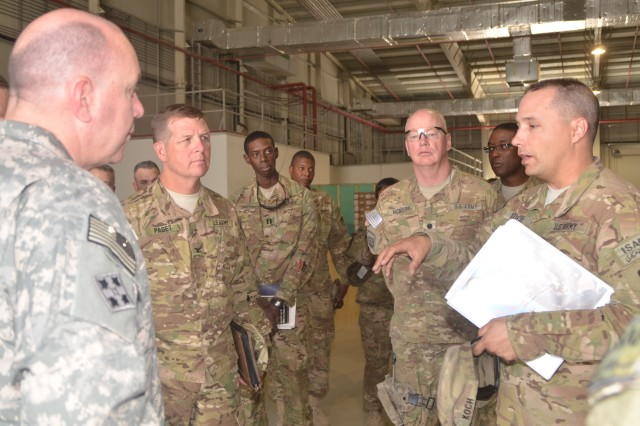 Lt. Col. Peter J. Koch, commander, Army Field Support Battalion-Bagram,  401st Army Field Support Brigade, briefs Maj. Gen. Thomas J. Richardson, commanding general, Military Surface Deployment and Distribution Command, on the redistribution property assistance team mission his battalion executes supporting retrograde of rolling stock and non-rolling stock from the Combined Joint Operations Area-Afghanistan. Richardson's command, SDDC, is a critical partner enabling the 401st to meet its mission.