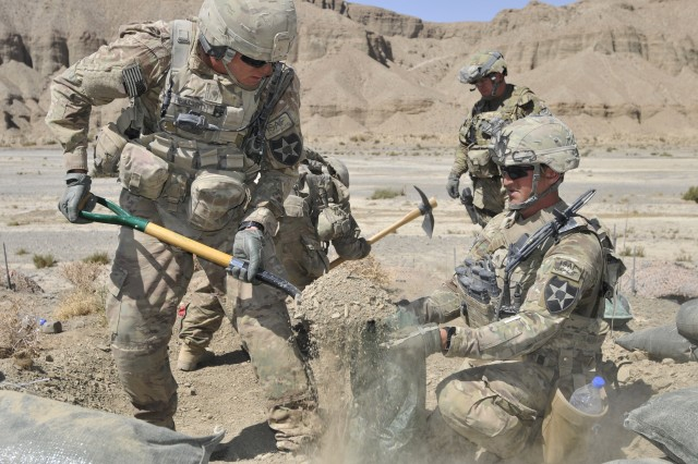 From left, Spc. Justin Heimsoth and Sgt. Chris Hagen fill sandbags for a machine gun position during Operation Southern Fist in Afghanistan's Spin Boldak district, Sept. 29, 2012. The Afghan-led operation focused on denying the enemy freedom of maneuver and to connect local villagers with the Afghan government. Both soldiers are infantrymen with the 2nd Infantry Division's 5th Battalion, 20th Infantry Regiment, 3rd Stryker Brigade Combat Team.