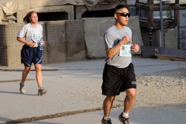 U.S. Army Spc. James Yi, a legal clerk working for NATO Training Mission-Afghanistan, who originally deployed from the 13th Expeditionary Sustainment Command from Fort Hood, Texas, participates in the Army Ten-Miler shadow run at Camp Eggers, Kabul, Afghanistan, Oct. 7, 2012. The run started at 6 a.m. to ensure low traffic on the run routes. Eggers is such a small place that runners had to do 16 laps on the designated track to cover ten miles.