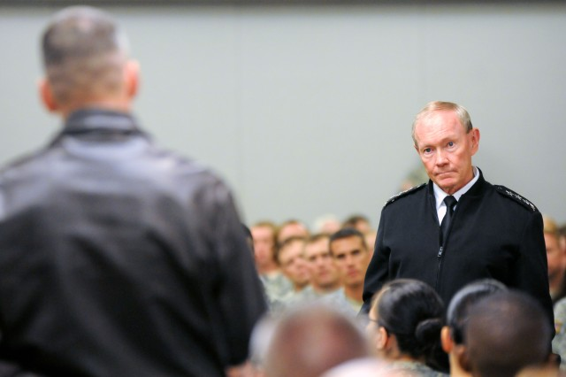 Gen. Martin Dempsey, chairman of the Joint Chiefs of Staff, listens to an airman's question during the Oct.1, 2012, town hall at Fort Riley, Kan. Dempsey visited the Flint Hills post following a stop at Kansas State University where he spoke to more than 1,000 Soldiers, students, faculty and staff, and community members about the importance of helping veterans return to work, school and their families following more than a decade of war.