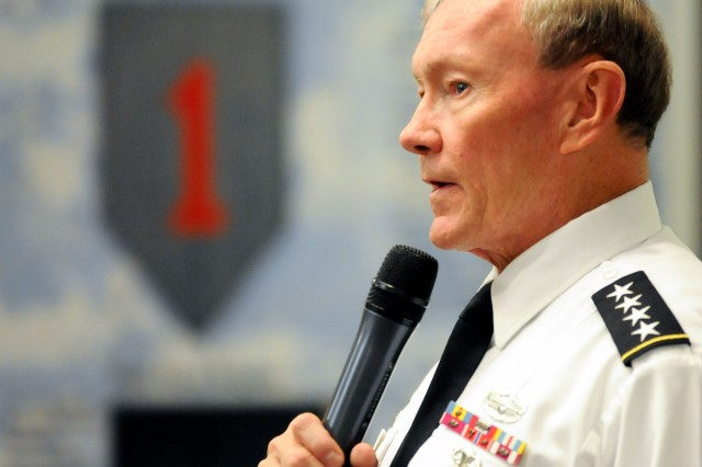 Gen. Martin Dempsey, chairman of the Joint Chiefs of Staff, talks to a crowd of Soldiers, family members and Army civilians during an Oct.1, 2012, town hall at Fort Riley, Kan. Dempsey visited the Flint Hills post following a stop at Kansas State University where he spoke to more than 1,000 Soldiers, students, faculty and staff, and community members about the importance of helping veterans return to work, school and their families following more than a decade of war.