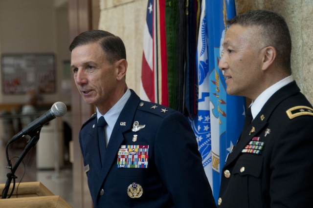 U.S. Air Force Maj. Gen. Byron Hepburn and Army Maj. Gen. M. Ted Wong speak during the San Antonio Military Health System's one-year anniversary at the San Antonio Military Medical Center Sept. 14. Hepburn is the SAMHS director and the 59th Medical Wing commander. Wong is the SAMHS deputy director, Brooke Army Medical Center and Southern Regional Medical Command commander.
