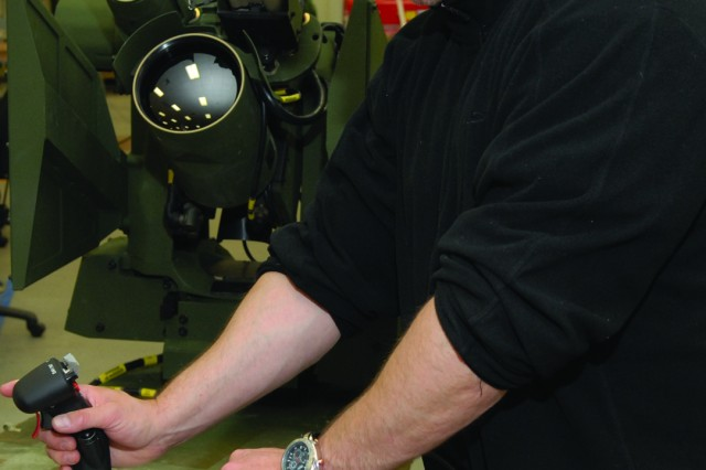 Electronics Mechanic James Bamert tests and aligns a Common Remotely Operated Weapon Station at Tobyhanna Army Depot, Pa.
