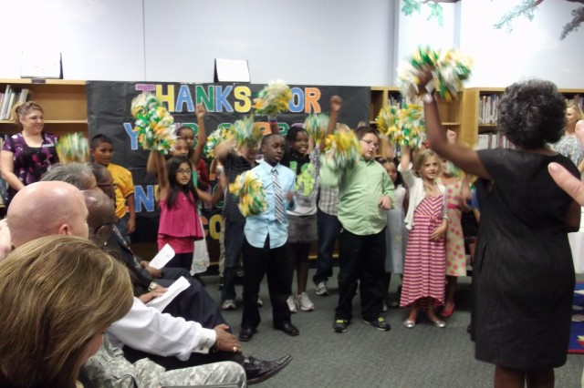 Amid the songs, cheers and thanks of student ambassadors, the U.S. Army Environmental Command recently renewed its Adopt-A-School partnership with the Fort Sam Houston Elementary School at a signing ceremony held at the school.