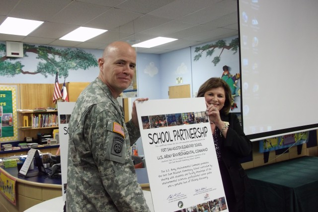 """""""This partnership will help students to become more effective and involved with the end result being better informed and more involved American citizens,"""" said Dr. Gail Siller, Superintendent of Fort Sam Houston Independent School District, shown here with USAEC Command Col. Mark A. Lee."""