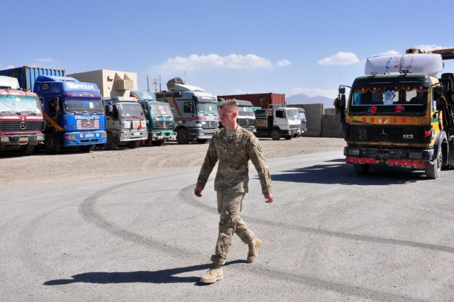 Spc. Joshua M. Atwell, a transportation specialist with the 622nd Movement Control Detachment, escorts a vehicle to a holding area on Oct. 3, 2012 at Forward Operating Base Shank. The 622nd MCT can house more than 100 host nation delivery trucks in their ground yard.