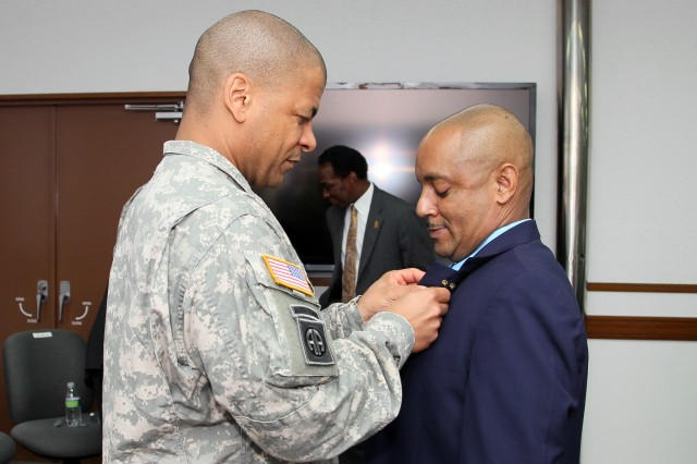 CAMP ZAMA, Japan (Oct. 10, 2012) -- Col. Michael C. Lopez, commander of the 403rd Army Field Support Brigade, pins to Jose A. Toro, director of the Logistics and Readiness Center Honshu during a ceremony held Oct. 10 at U.S. Army Garrison Japan headquarters. The LRC, formerly under the Directorate of Logistics at USAG-J, now falls under Army Materiel Command as of Oct. 1.
