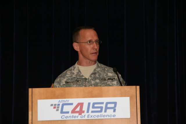 Col. Ed Swanson, project manager for Warfighter Information Network-Tactical, addressed the audience during the final fielding celebration of WIN-T Increment 1, Aug. 23, 2012, at Aberdeen Proving Ground, Md.