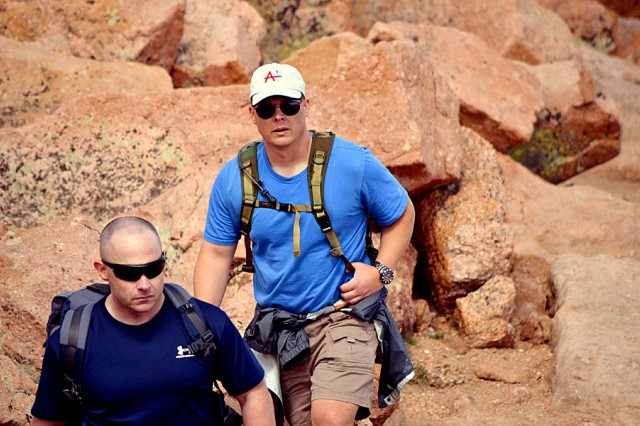 Capt. Darin Lindon, Headquarters and Headquarters Company commander, U.S. Army Space and Missile Defense Command/Army Forces Strategic Command, right, and 1st Sgt. Joshua Ochs, HHC first seargeant, climb Pike's Peak Aug. 30. Lindon joined the Army in 1999.