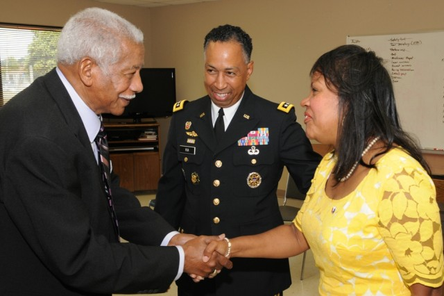 Gen. Dennis Via, commander of the Army Materiel Command, and his wife Linda congratulate Ray Williams on receiving the Congressional Gold Medal.