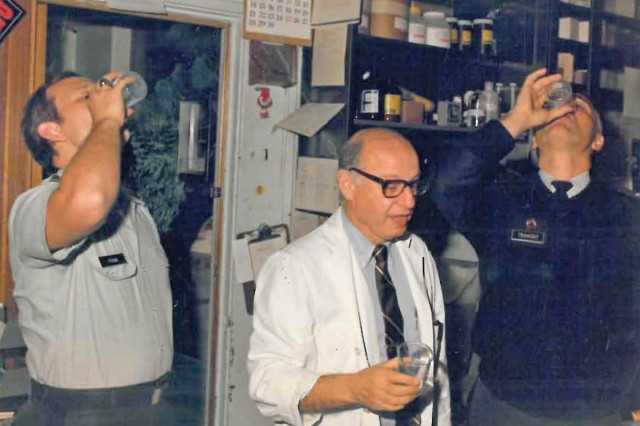 Dr. Edmund C. Tramont (left) and two colleagues drink an experimental vaccine against shigella at Walter Reed Army Medical Center, Washington, D.C., about 1988.