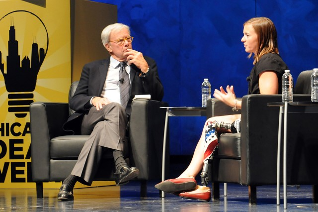 (Left)Tom Brokaw, renowed television jounalist and author, listens to Melissa Stockwell, retired Army Lieutenant and on April 13, 2004 became the first female to lose a limb during Operation Iraqi Freedom, discuss her deployment experience and how her loss has made her stronger.  Stockwell is also a 2008 Parlympian in the sport of swimming and the current 2x Paratriathlon World Champion.