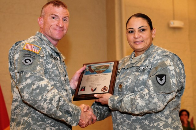 Col. Scott Lofreddo, chief of staff, Army Sustainment Command, presents Maj. Carmen Rosado her award of recognition in honor of previous accomplishments. (Photo by Liz Adolphi, ASC Public Affairs)
