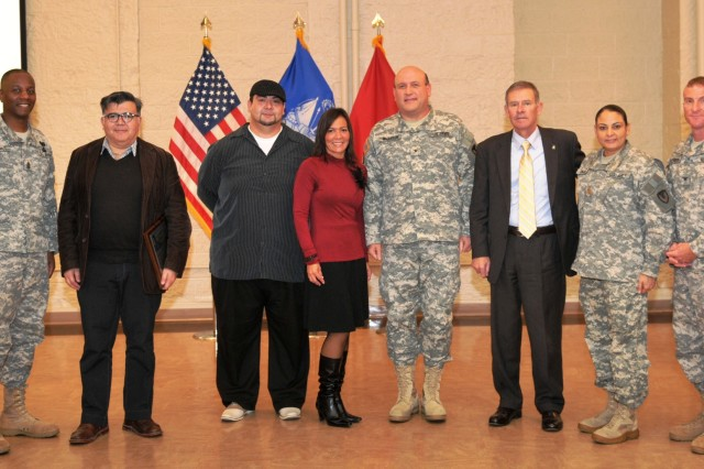 Brig. Gen. John F. Wharton, commanding general, Army Sustainment Command, stands with, from left, Command Sgt. Maj. Anthony M. Bryant, Joint Munitions Command; Prof. Santiago Vazuera Vásquez, University of Iowa; Alex Vazquez, Salsa Touch Latin Dance and Fitness Studio student; Bettinna Bolger-Diaz, Salsa Touch Latin Dance and Fitness Studio owner and instructor;  Joel Himsl, Rock Island Arsenal garrison manager; Maj. Carmen J. Rosado, Army Sustainment Command; and Col. Scott Lofreddo, ASC chief of staff. (Photo by Liz Adolphi, ASC Public Affairs)