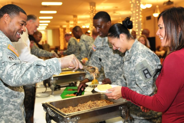 A Soldier serves Bettinna Bolger-Diaz samples of Hispanic food to celebrate the promise of continued diversity. (Photo by Liz Adolphi, ASC Public Affairs)